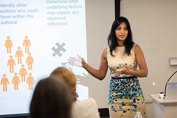 Dr. Bamini Jayabalasingham, Senior Analytical Product Manager at Elsevier, presents the findings of a paper she co-authored with Harvard and Elsevier colleagues. (Photo by Alison Bert)