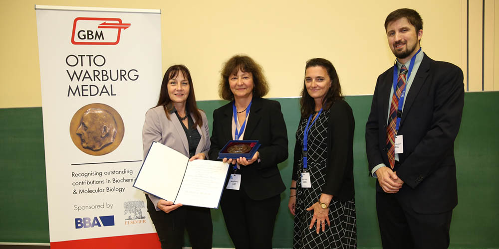 Prof. Annette Beck-Sickinger, President of the GBM, Prof. Marina Rodnina of the Max Planck Institute for Biophysical Chemistry, Petra Ullrich, Marketing Director Europe at Elsevier, and George Woodward, Executive Publisher at Elsevier