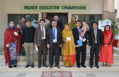 Winners and family pose with members of HEC. They include the overall winner of the Quiz for Science, Dr. Muhammad Nouman Aslam Khan (front row, second from left), and Dr. Tariq Mehmood, R&D Advisor for HEC (front row, fourth from left), with first runner-up, Dr. Sajida Noureen (front row, 4th from right). Absent from the photo is second runner-up, Syed Hani Abidi.