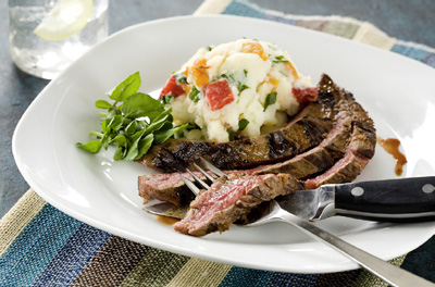 Grilled Flank Steak with Garlic-enhanced Mashed Potatoes. The recipe for the potatoes appears below and on p. 533 in Culinary Nutrition. (Photo © 2014 Grace Natoli Sheldon. Reprinted with permission)