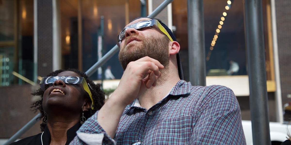 Angelica Kerr, Publishing Support Insights Specialist, and Michael Weston, Executive Publisher, Ophthalmology and Pathology, watch the exclipse outside Elsevier's New York Office. Michael came with plenty of glasses for those of us who waited too long to buy them. (Photos of New York by Alison Bert)