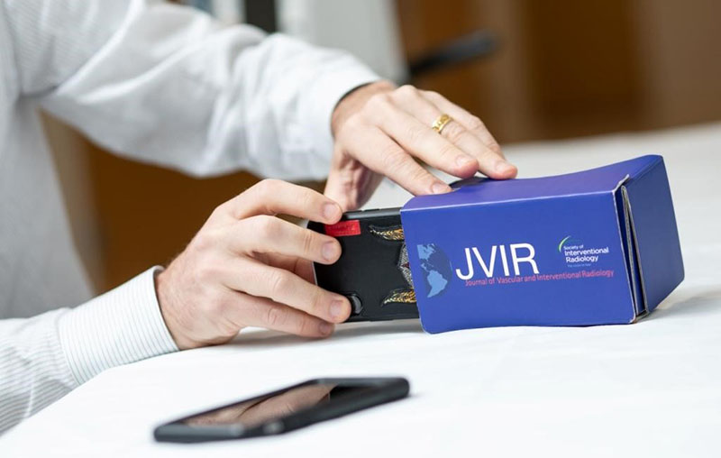 Prof. Ziv J Haskal, MD, demonstrates the JVIR Google cardboard VR viewer.