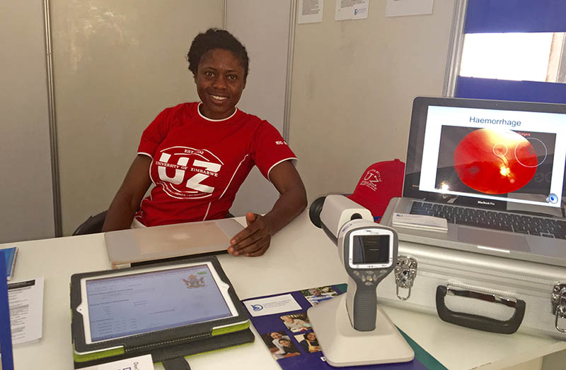 Dr. Alice Matimba, researcher and Senior Lecturer in the Department of Clinical Pharmacology at the University of Zimbabwe, with the handheld ophthalmoscope for eye screening her team designed.