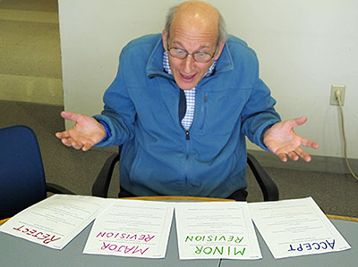 A confused editor (author Richard B. Primack in a staged photo) contemplates four divergent reviews of the same paper while attempting to make a fair decision on its fate. (Photo by Amanda Gallinat)