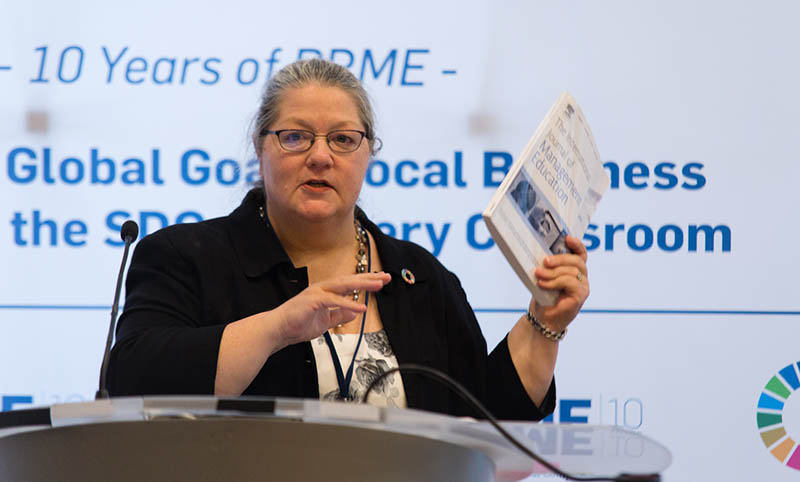 Dr. Carole Parkes holds up Elsevier's special Issue of the International Journal of Management Education at a conference preceding the UN High Level Political Forum (UNHLP) in New York.