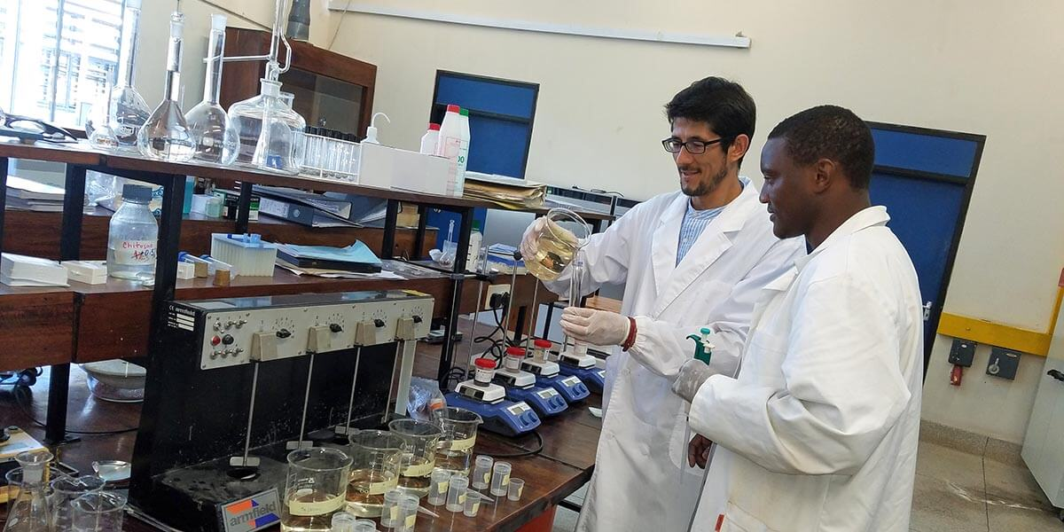 Dr. Mirabbos Hojamberdiev (left) works with a researcher at the the University of Dar es Salaam in Tanzania on research that will contribute to clean water accessibility.