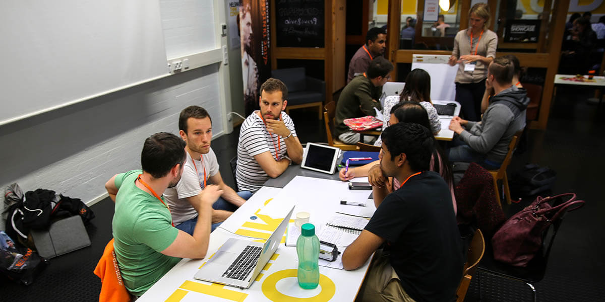 The Powercards team works on their app at Elsevier Hacks in Helsinki. (Photo by Todd Fredericks)