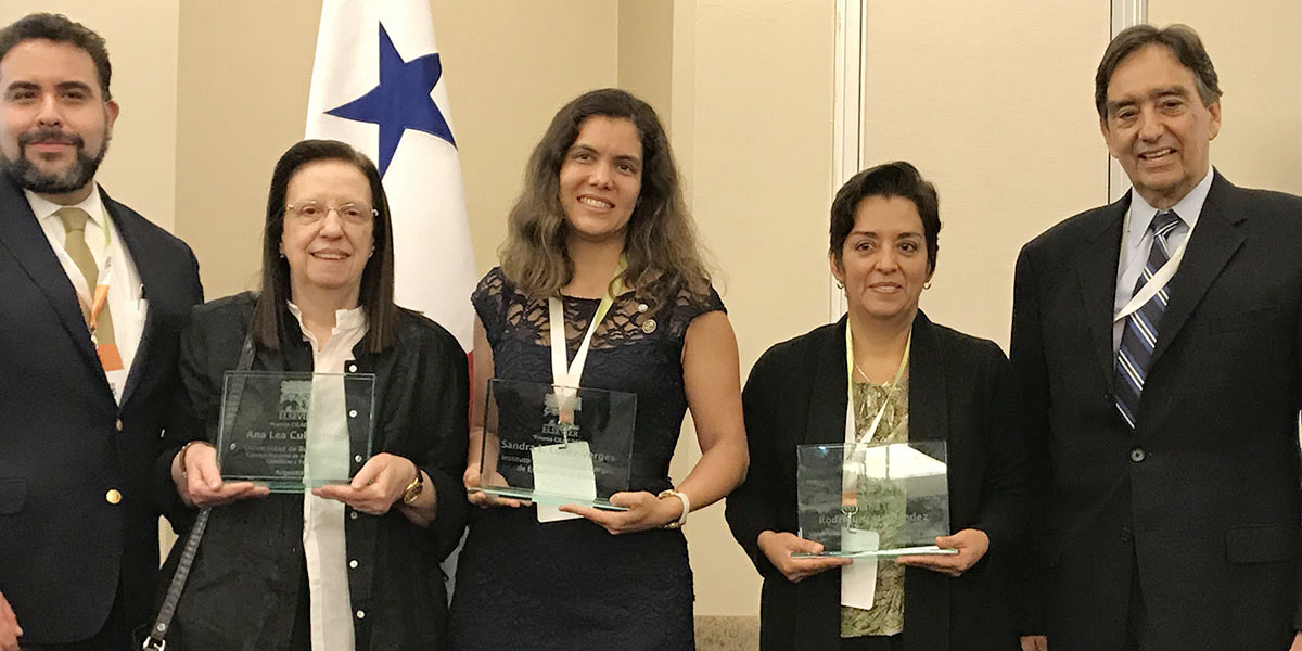 Winners pose at the ceremony for the Research Excellence Elsevier-Senacyt Award: Prof. Ana Lea Cukierman of the Universidad de Buenos Aires and Consejo Nacional de Investigaciones Científicas y Técnicas in Argentina; Dr. Sandra López Vergés of the Gorgas Memorial Institute of Health Studies in Panama; and Prof. Adriana Inés Rodríguez of the Autonomous University of Hidalgo State in Mexico. Not pictured is Prof. Camila Alves de Rezende of the Institute of Chemistry at University of Campinas in São Paulo, Brazil, who was unable to attend. They are flanked by Francisco Corpi, Regional Sales Manager for Latin America at Elsevier (left) and Dr. Jorge Motta, Panama's Secretary of Science, Technology and Innovation. (Photocourtesy of SENACYT)