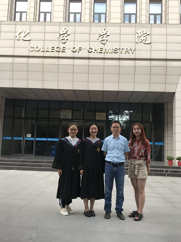 Prof Lu, above, with some student graduates