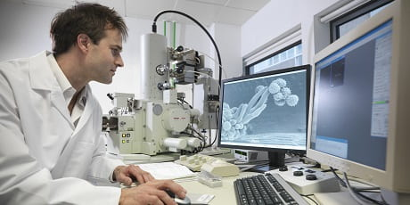 Male scientist learning the Reaxys Predictive Retrosynthesis' differences