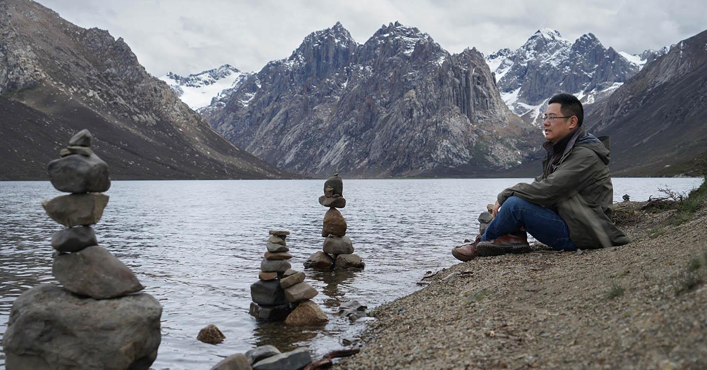 Huai Chen beside glacial lake on Tibetan Plateau