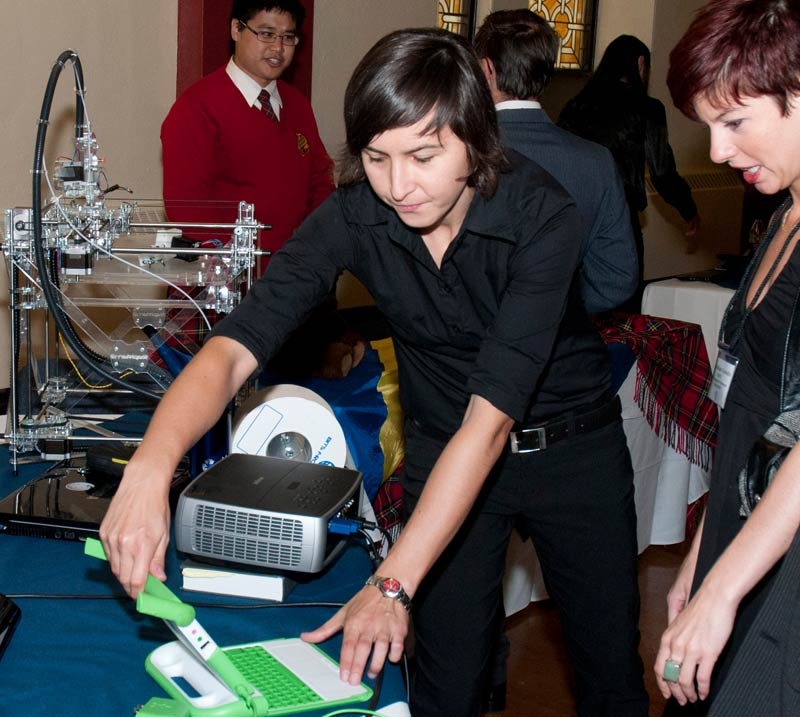 Former student Ivana Zelenika demonstrates a first-generation RepRap and an]n OLPC (One Laptop Per Child) laptop for potential 3D printing applications in the developing world.