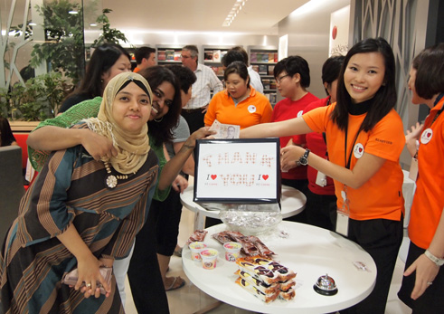 Elsevier employees hold an RE Cares ice cream sale to raise  money to build the school.