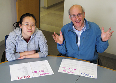 The reviews of papers from China tend to be more negative and consistent than reviews of papers from the US and other English-speaking countries, resulting in a greater rejection rate of papers from China. Here, author Richard B. Primack poses in a staged photo with Yang Yu, a Boston University student from China.