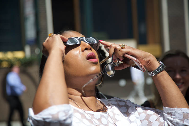 Carol Elias watches the eclipse in New York City.
