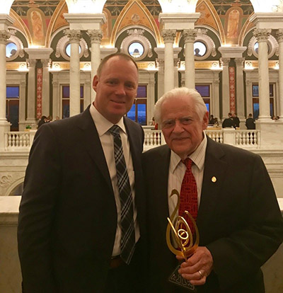 Stanley Cohen, MD, poses with Elsevier's Tom Reller after the award ceremony.
