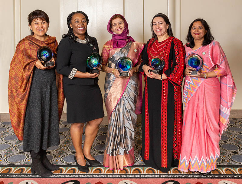 The winners pose wtih their awards after the ceremony (from left): Narel Paniagua-Zambrana, PhD (Bolivia); Uduak Okomo, PhD (The Gambia); Tabassum Mumtaz, PhD (Bangladesh); Amira Shaheen, PhD (Palestine); and Tista Prasal Joshi, PhD (Nepal). (Photo by Alison Bert)