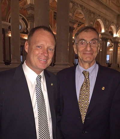 Joel E. Cohen, PhD (right) poses with Tom Reller, VP of Corporate Relations at Elsevier and the author of this story.