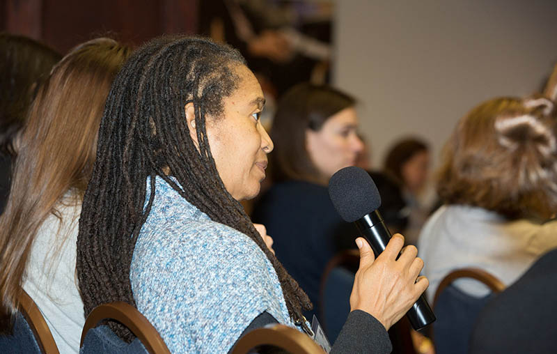 Audience members ask questions after the panel discussion.