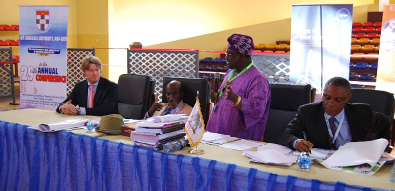 The signing ceremony: standing is Professor Michael Foborode, Secretary General of the Association of Vice-Chancellors of Nigerian Universities (AVCNU), with Professor Michael Ajisafe, Vice Chancellor of Afe-Babalola University, Ado-Ekiti (left) and Professor Joseph Atubokiki Ajienka, Vice Chancellor of the University of Port-Harcourt and Chairman of AVCNU (right).