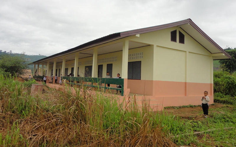 This school building replaced the open-air straw-roof huts that were an invitation  to distractions, including unwanted visitors like cows and snakes.