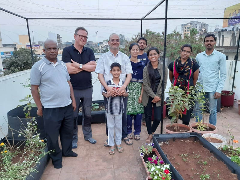 Ankur (third from left) at home with his family and students. By his side is Rob van Daalen, author of this story.