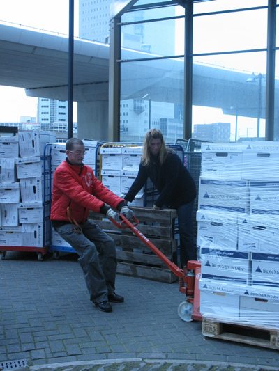 Frank Franssen and Sylvia Weidema of Elsevier's Facilities department in Amsterdam prepare to send a shipment of books to India, where their supplier will scan and digitize the books.