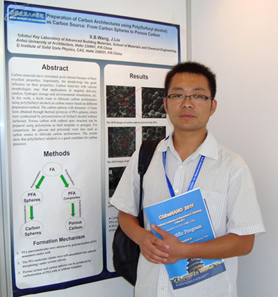 Author and chemistry professor Xianbiao Wang, PhD, of  Anhui Jianzhu University in China with a poster of his team's research.