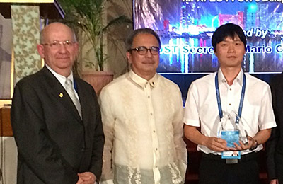 Dr. Jong-Seong Kug (right), winner of the 2015 ASPIRE award, with Secretary Mario Montejo (center) of the Philippine Department of Science & Technology. Dr. Brad Fenwick (left), Senior VP of Government & Academic Relations, represented Elsevier at the award ceremony as executive sponsor of this program.