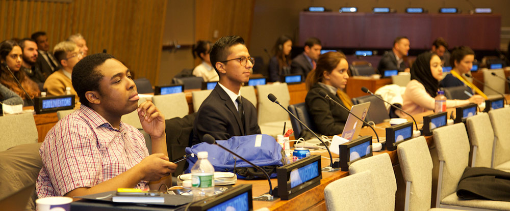 Nelson Igunma of Brooklyn, who was participating in the ECOSOC Youth Forum, listens to the presentation.