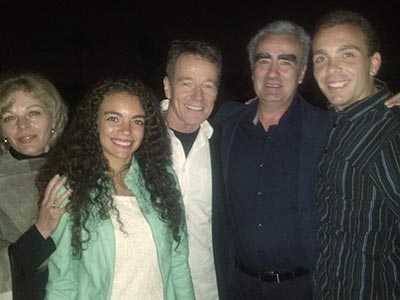 Bryan Cranston (center), who played Walter White in Breaking Bad, surrounded by Marius Stan's family (Photos courtesy of Marius Stan)