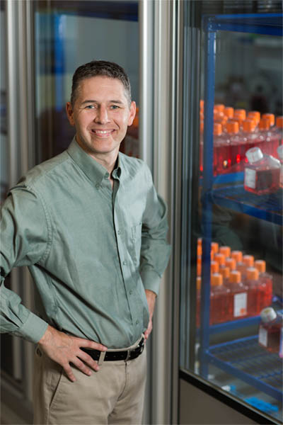 Prof. Shane Crotty, PhD, in his lab, where he and his team study immunity against infectious diseases. (Photo courtesy of the La Jolla Institute for Immunology)