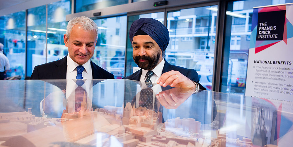 Dr. Harpal Kumar, CEO of Cancer Research UK (right) shows Elsevier CEO Ron Mobed a model of the Francis Crick Institute, due to open in 2016.