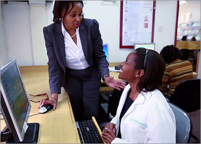 Medical Librarian Nasra Gathoni (seated) works with a doctor at Aga Khan University Hospital in Kenya.
