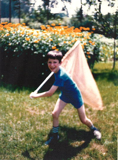 Paul-André with his butterfly net. Starting at age 7, he would collect insects as part of his early fascination with biology.