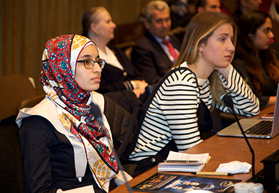 Rahma Ahmed, a student at Bard High School Early College, and Ayla Ojjeh, a media and politics student at NYU, listen to the presentation. They were both enrolled in the ECOSOC Youth Forum.