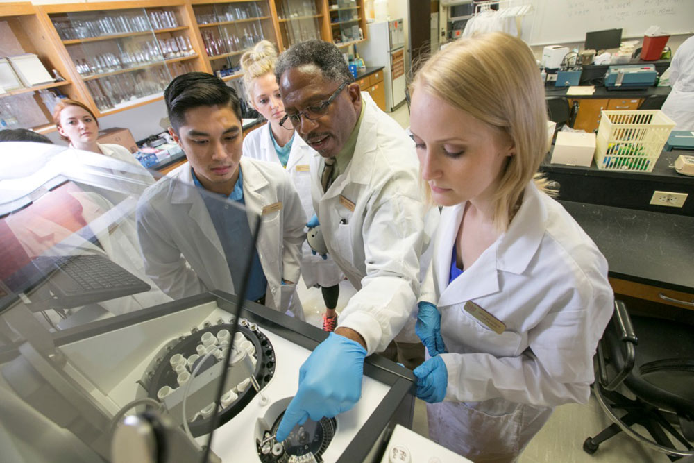 Dr. Gerald D. Redwine instructs Texas State students in clinical chemistry.
