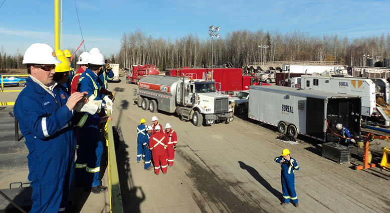 The well pad is very busy during hydraulic fracturing. This is a fracking site at Fox Creek, Alberta, Canada. (Photo by Mike Stephenson)