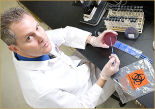 Rodney E. Rohde, PhD, in his lab at Texas State University