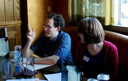 At the Asgard Irish Pub in Cambridge, Massachusetts, Andy Greenspon talks with fellow graduate students from Harvard and MIT at an Ask for Evidence workshop organized by Sense About Science. He grew up near Boston and chose to go to graduate school there. (Photo by Alison Bert)
