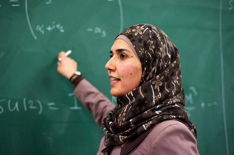 """Doa Hawamdeh, master's student at Birzeit University. """"I think physics is the mother of all the sciences."""" (Photo by Jack Owen)"""