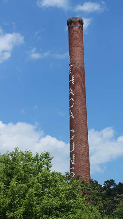 The smokestack is the only remnant of the Ithaca Gun Factory after the factory was demolished (Photo by Grace Livermore)