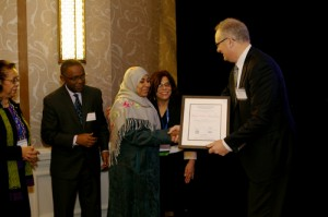 "Dr. Huda Omer Basaleem of Yemen accepts her award from David Ruth, Executive Director of the Elsevier Foundation, the AAAS conference in February. She was recognized for ""her dedication in the fight against cancer and for the well-being of women and children in the Arab region."" She is surrounded by (left to right) Dr. Shirley Malcom, Head of Education and Human Resources for AAAS, Dr. Romain Murenzi, Executive Director of TWAS and Professor Maya de la Torre, Vice President, Latin America, OWSD. (Photos by Alison Bert)"