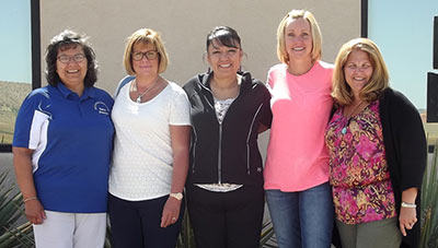 Michelle Kellywood-Yazzie (center) poses with colleagues (from left to right): Clare Landavazo, school counselor and contact for service project; Cheryl Mee, MSN, MBA, RN; Michelle Kellywood-Yazzie, RN, MSN; Dottie Prior, BSN, RN, CEN; and Kim Mikula, BSN, RN, CEN.