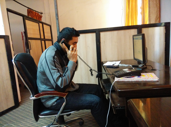 Doctor responding to mobile phone-based telemedicine call from the site at Kathmandu (Photo by Rajan Parajuli)