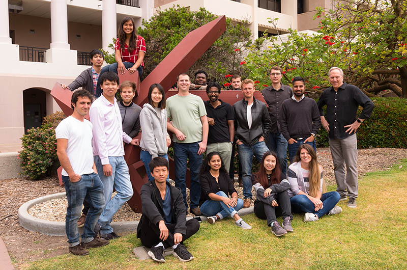 Prof. Bruce Lipshutz with his students outside the research center at UC Santa Barbara.