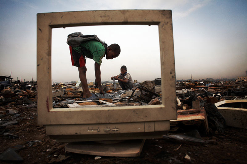Children break apart computer monitors to salvage metal from inside at Agbogbloshie dump in Ghana. It's from an article on e-waste recycling, which won the Atlas Prize in August. (Credit: Andrew McConnell/Panos)