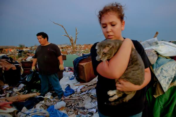 Moore, Oklahoma, May 23 — Moore resident Kristy Parrish finds her cat Oscar after four days of being buried in the rubble. Oscar suffered a broken leg, but otherwise was fine. The Moore area was struck by an F5 tornado on May 20. (Photo by Andrea Booher/FEMA)