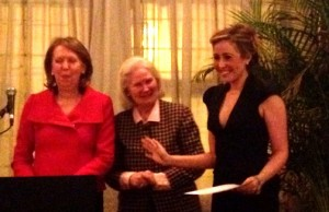 Dr. Lily Khidr accepts her graduation certificate from UN Worldview Institute Executive Director Ann Nicol (at podium) and President Paula Rice-Jackson (center).